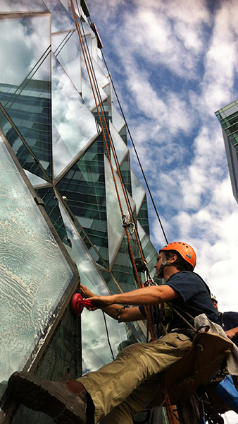 High rise builders clean to remove protective coating in Melbourne CBD