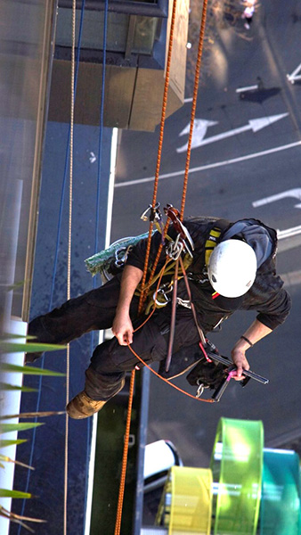 Industrial Rope Access using the twin-rope method for inaccessible window cleaning